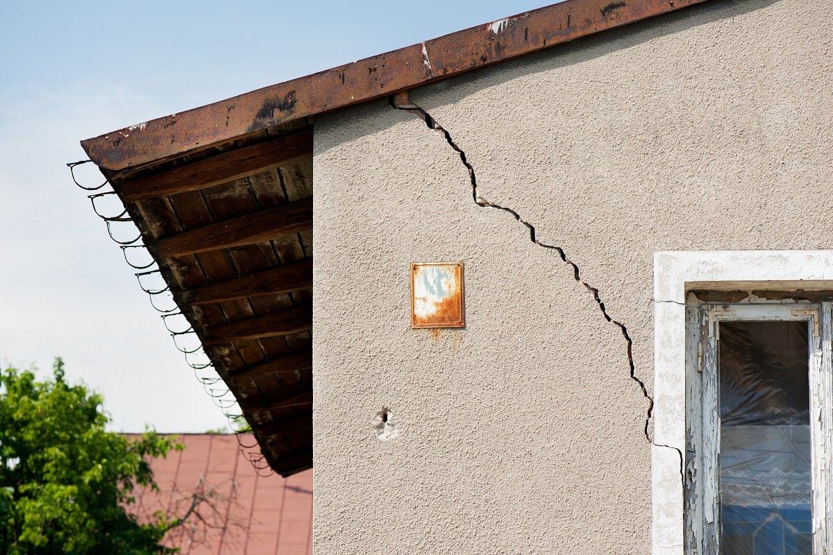 A house with cracks in the exterior wall